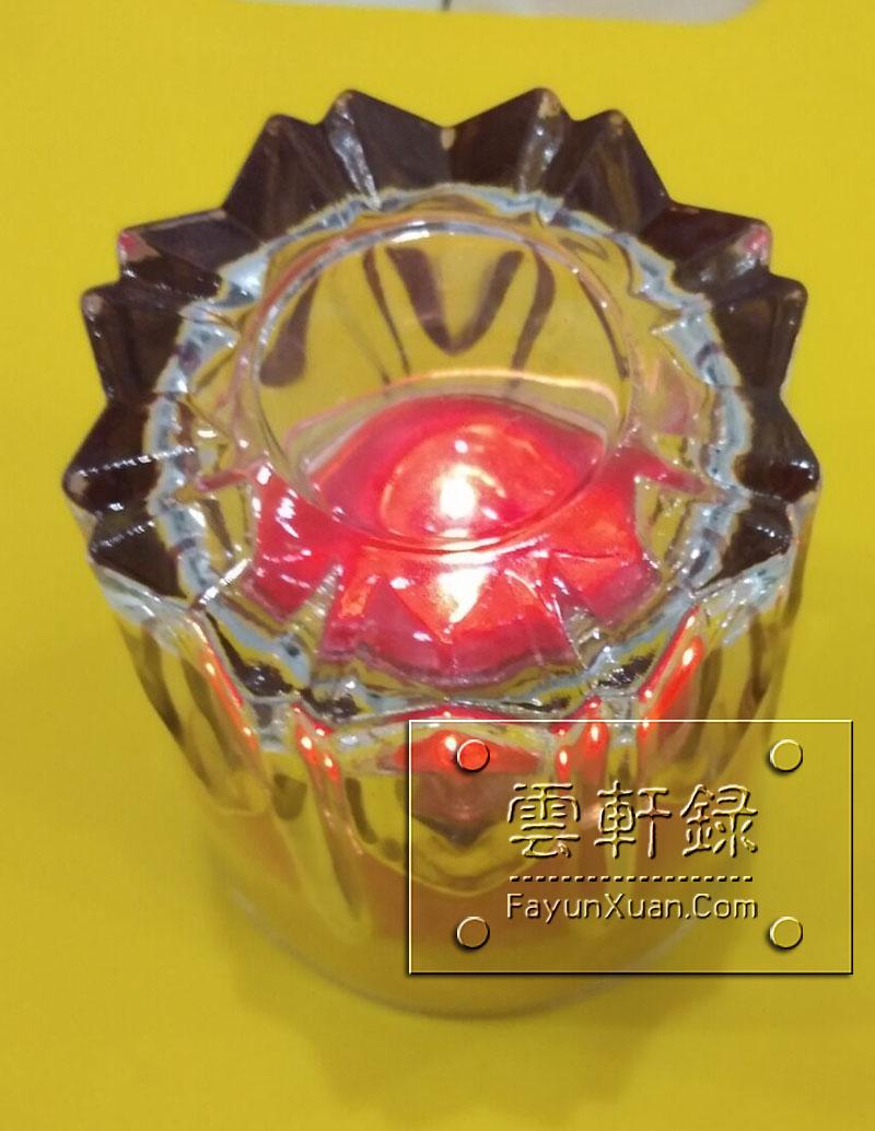 燃烧着的酥油灯盖上玻璃杯一.jpg